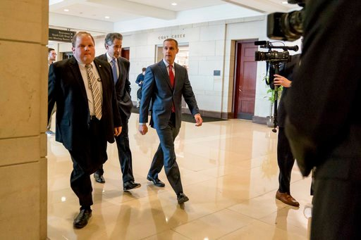 (AP Photo/Andrew Harnik). President Donald Trump's former campaign manager Cory Lewandowski, center, and his lawyer Peter Chavkin, second from left, arrive to meet behind closed doors with the House Intelligence Committee, at the Capitol in Washington,...