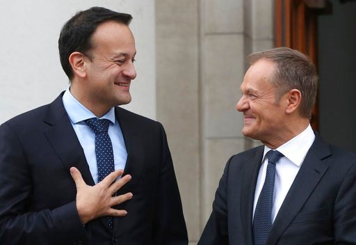 (Brian Lawless/PA via AP). EU Council president Donald Tusk, right,  arrives for talks with Irish Prime Minister  Leo Varadkar at Government Buildings in Dublin Thursday March 8, 2018.