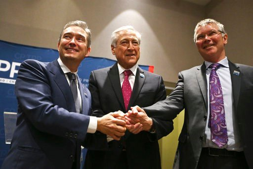 (AP Photo/Esteban Felix). Canada's Minister of International Trade Francois-Philippe Champagne, Chile's Foreign Minister Heraldo Munoz and New Zealand's Trade Minister David Parker, pose for a photograpghers before a signing ceremony of the Comprehensi...