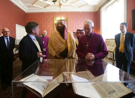 (Yui Mok/PA via AP). The Archbishop of Canterbury Justin Welby,  right,  accompanies the Crown Prince of Saudi Arabia, Mohammed bin Salman, centre, as they view The Birmingham Quran manuscript - one of the earliest surviving records of the Quran, writt...