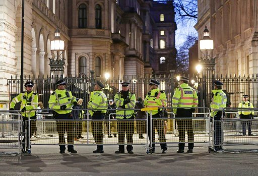 (Yui Mok/PA via AP). British police officers secure the area outside Downing Street in London, as protesters demonstrate against the visit by Saudi Arabia's Crown Prince Mohammed bin Salman, Wednesday March 7, 2018.  Saudi Arabia's Crown Prince Mohamme...