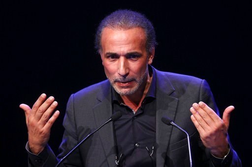 (AP Photo/Michel Spingler, File). FILE - In this Feb.7, 2016 file photo, Muslim scholar Tariq Ramadan delivers a speech during a French Muslim organizations meeting in Lille, northern France. A third woman has filed a rape complaint against prominent I...