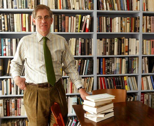 (AP Photo/Kathy Willens, File). FILE - In this April 7, 2005 file photo, Jonathan Galassi, president and publisher of Farrar, Straus and Giroux, stands beside a stack of books that during his tenure have been awarded four National Book Awards and three...