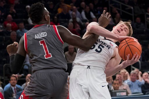 (AP Photo/Mary Altaffer). St. John's guard Bashir Ahmed (1) guards Xavier guard J.P. Macura (55) during the first half of an NCAA college basketball game in the quarterfinals of the Big East conference tournament, Thursday, March 8, 2018, at Madison Sq...