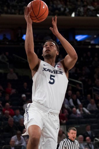 (AP Photo/Mary Altaffer). Xavier guard Trevon Bluiett goes to the basket during the first half of an NCAA college basketball game against St. John's in the quarterfinals of the Big East conference tournament, Thursday, March 8, 2018, at Madison Square ...
