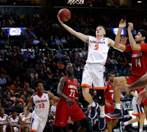 (AP Photo/Frank Franklin II). Virginia's Kyle Guy (5) drives past Louisville's Anas Mahmoud (14) during the second half of an NCAA college basketball game in the quarterfinal round of the Atlantic Coast Conference tournament Thursday, March 8, 2018, in...