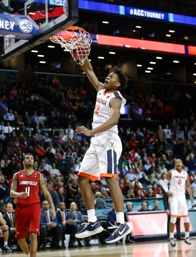 (AP Photo/Frank Franklin II). Virginia's De'Andre Hunter (12) dunks the ball in front of Louisville's Quentin Snider (4) during the second half of an NCAA college basketball game in the quarterfinal round of the Atlantic Coast Conference tournament Thu...