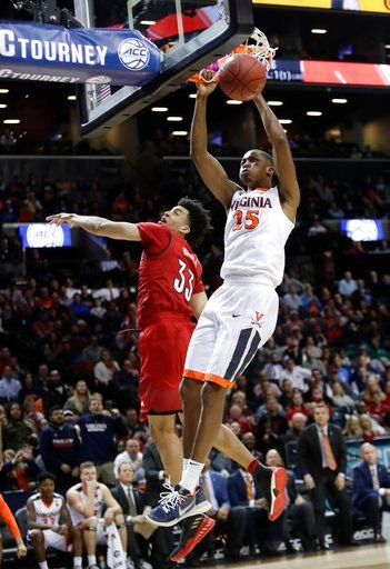 (AP Photo/Frank Franklin II). Virginia's Mamadi Diakite (25) dunks the ball in front of Louisville's Jordan Nwora (33) during the second half of an NCAA college basketball game in the quarterfinal round of the Atlantic Coast Conference tournament Thurs...