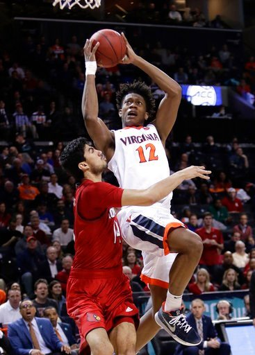 (AP Photo/Frank Franklin II). Virginia's De'Andre Hunter (12) shoots over Louisville's Anas Mahmoud (14) during the second half of an NCAA college basketball game in the quarterfinal round of the Atlantic Coast Conference tournament Thursday, March 8, ...