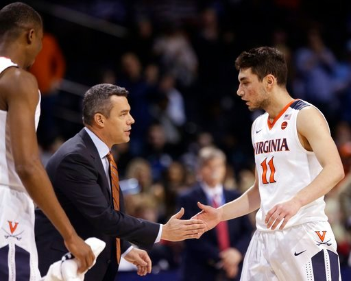(AP Photo/Frank Franklin II). Virginia head coach Tony Bennett talks to Ty Jerome (11) during the first half of an NCAA college basketball game against Louisville in the quarterfinal round of the Atlantic Coast Conference tournament Thursday, March 8, ...