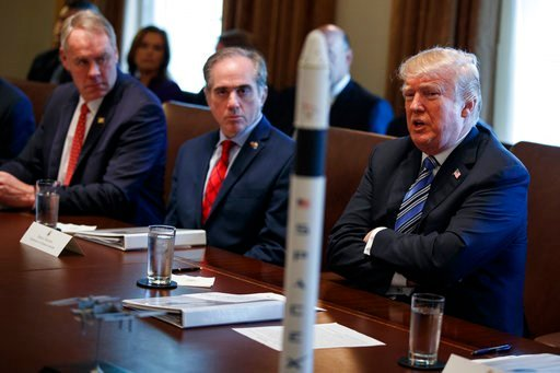 (AP Photo/Evan Vucci). Secretary of the Interior Ryan Zinke, left, and Secretary of Veterans Affairs David Shulkin, center, listen as President Donald Trump speaks during a cabinet meeting at the White House, Thursday, March 8, 2018, in Washington.