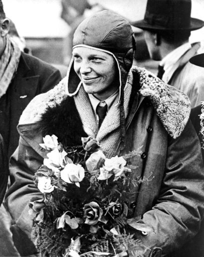 "(AP Photo, File). FILE - In a June 26, 1928 file photo, American aviatrix Amelia Earhart poses with flowers as she arrives in Southampton, England, after her transatlantic flight on the ""Friendship"" from Burry Point, Wales. Bones found in 1940 on a wes..."