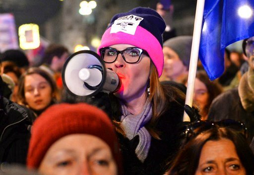 (AP Photo/Alik Keplicz). Protesters take part in a Women's Day march in Warsaw, Poland, Thursday, March 8, 2018. A few thousand women and men chanting women's rights slogans marched through  central Warsaw to mark the International Women's Day.