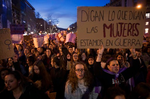 (AP Photo/Emilio Morenatti). Women march as they shout slogans during the International Women's Day in Barcelona, Spain, Thursday, March 8, 2018. Spanish women are marking International Women's Day with the first-ever full day strike and dozens of prot...