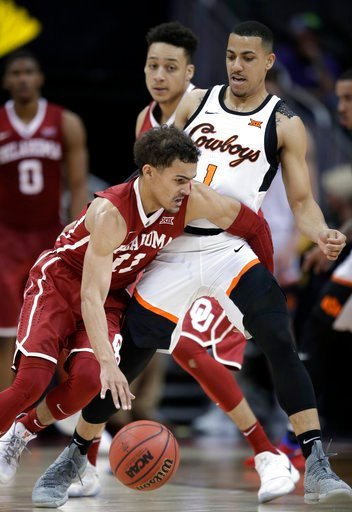 (AP Photo/Orlin Wagner). Oklahoma guard Trae Young (11) works around Oklahoma State guard Kendall Smith (1) during the first half of an NCAA college basketball game in first round of the Big 12 men's tournament in Kansas City, Mo., Wednesday, March 7, ...