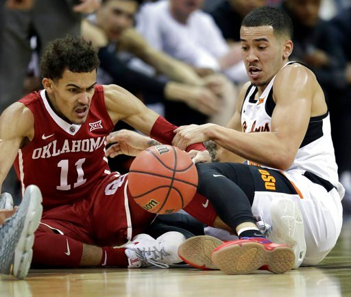 (AP Photo/Orlin Wagner). Oklahoma guard Trae Young (11) goes to the floor for a loose ball with Oklahoma State guard Jeffrey Carroll, right, during the first half of an NCAA college basketball game in first round of the Big 12 men's tournament in Kansa...