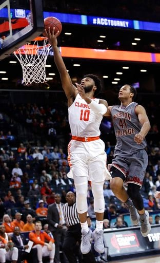 (AP Photo/Frank Franklin II). Clemson's Gabe DeVoe (10) drives past Boston College's Steffon Mitchell (41) during the second half of an NCAA college basketball game in the quarterfinal round of the Atlantic Coast Conference tournament Thursday, March 8...