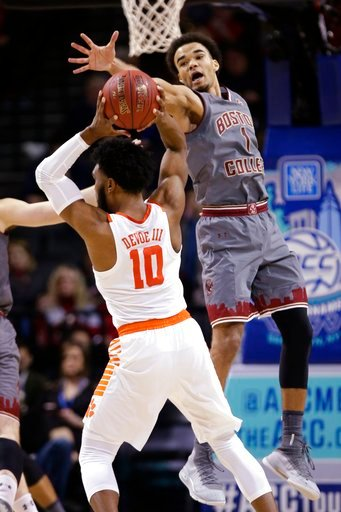 (AP Photo/Frank Franklin II). Boston College's Jerome Robinson (1) defends Clemson's Gabe DeVoe (10) during the first half of an NCAA college basketball game in the quarterfinal round of the Atlantic Coast Conference tournament Thursday, March 8, 2018,...