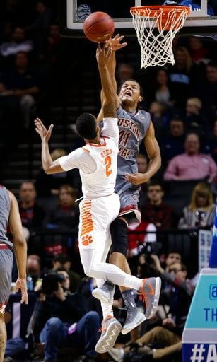 (AP Photo/Frank Franklin II). Boston College's Steffon Mitchell (41) blocks a shot by Clemson's Marcquise Reed (2) during the first half of an NCAA college basketball game in the quarterfinal round of the Atlantic Coast Conference tournament Thursday, ...