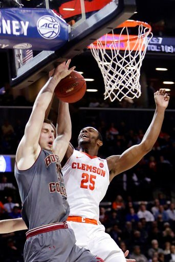 (AP Photo/Frank Franklin II). Clemson's Aamir Simms (25) defends against Boston College's Nik Popovic (21) during the first half of an NCAA college basketball game in the quarterfinal round of the Atlantic Coast Conference tournament Thursday, March 8,...