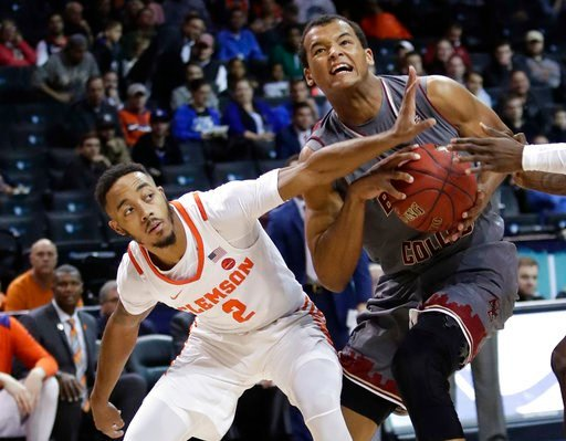 (AP Photo/Frank Franklin II). Boston College's Steffon Mitchell (41) looks toward the basket as Clemson's Marcquise Reed (2) defends during the first half of an NCAA college basketball game in the quarterfinal round of the Atlantic Coast Conference tou...