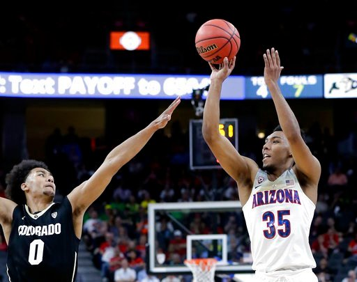 (AP Photo/Isaac Brekken). Colorado's D'Shawn Schwartz, left, covers a shot by Arizona's Allonzo Trier during the first half of an NCAA college basketball game in the quarterfinals of the Pac-12 men's tournament Thursday, March 8, 2018, in Las Vegas.