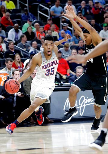 (AP Photo/Isaac Brekken). Arizona's Allonzo Trier (35) drives past Colorado's George King (24) during the first half of an NCAA college basketball game in the quarterfinals of the Pac-12 men's tournament Thursday, March 8, 2018, in Las Vegas.