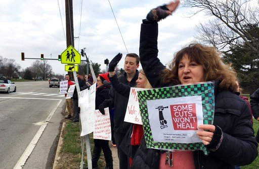 (AP Photo/Adam Beam). Su Sheridan holds a sign protesting proposed cuts to retirement benefits for public school teachers on Thursday, March 8, 2018 in Frankfort, Ky.  An art teacher at Elkhorn Middle School, Sheridan was one of hundreds of educators i...