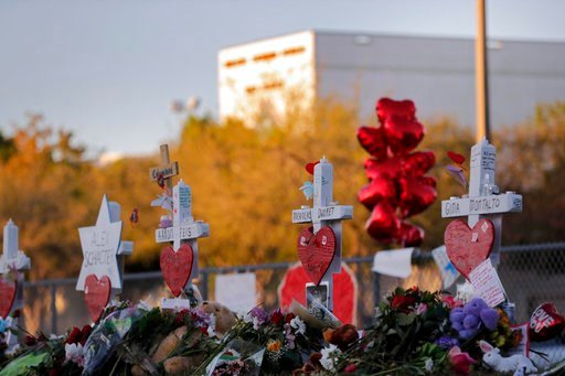 (AP Photo/Gerald Herbert, File). This Feb. 19, 2018 file photo shows a makeshift memorial outside Marjory Stoneman Douglas High School, where 17 students and faculty were killed in a mass shooting in Parkland, Fla. Parkland city's historian Jeff Schwar...