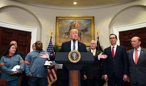 (AP Photo/Susan Walsh). President Donald Trump, center, speaks in the Roosevelt Room of the White House in Washington, Thursday, March 8, 2018, before signing two proclamations, one on steel imports and one on aluminum imports. Standing with Trump are ...