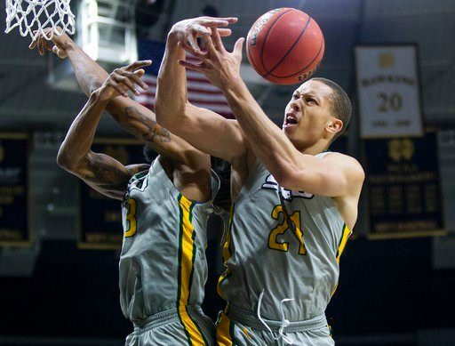 (Michael Caterina/South Bend Tribune via AP, File). FILE - In this Dec. 21, 2017, file photo, Southeastern Louisiana University's James Currington, left, and Jordan Capps (21) fight for a loose ball during an NCAA college basketball game against Notre ...