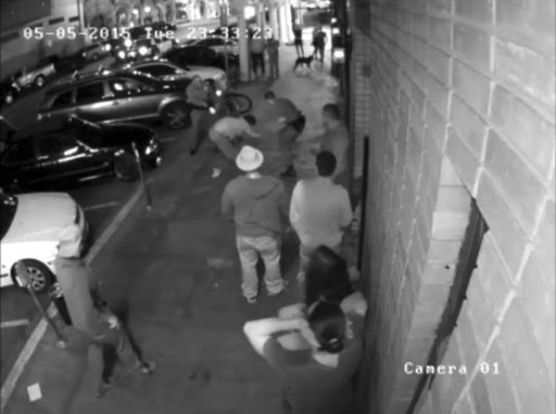 (Los Angeles County District Attorney's Office via AP). In this May 5, 2017 surveillance camera image released by the Los Angeles County District Attorney's Office, police officer Clifford Proctor is shown firing a second round at Brendon Glenn's lower...
