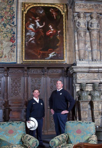 "(Victoria Garagliano/Hearst Castle/California State Parks via AP). In this undated photo provided by Hearst Castle/California State Parks are guides Laurel Rodger and Carson Cargill posing below the ""Annunciation"" painting hanging at Hearst Castle in S..."