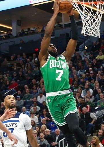 (AP Photo/Jim Mone). Boston Celtics's Jaylen Brown lays up as Minnesota Timberwolves' Taj Gibson, left, looks on in the first half of an NBA basketball game Thursday, March 8, 2018, in St. Paul, Minn.