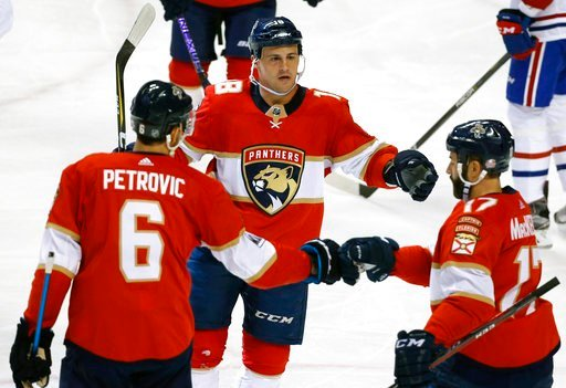 (AP Photo/Wilfredo Lee). Florida Panthers center Micheal Haley, center, celebrates with defenseman Alexander Petrovic (6) and center Derek MacKenzie (17) after scoring during the second period of an NHL hockey game against the Montreal Canadiens, Thurs...