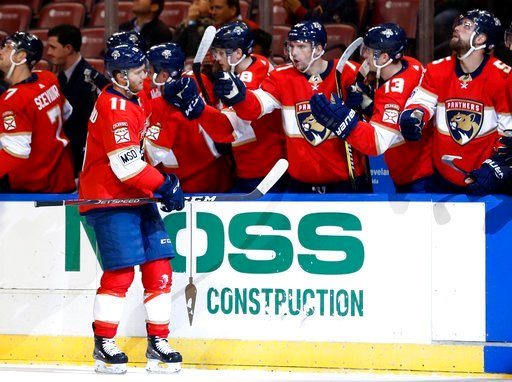 (AP Photo/Wilfredo Lee). Florida Panthers left wing Jonathan Huberdeau (11) is congratulated by teammates after scoring during the first period of an NHL hockey game against the Montreal Canadiens, Thursday, March 8, 2018, in Sunrise, Fla.