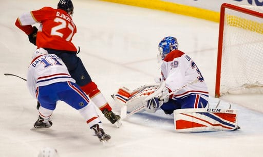 (AP Photo/Wilfredo Lee). Florida Panthers center Nick Bjugstad (27) scores against Montreal Canadiens right wing Brendan Gallagher (11) and goaltender Charlie Lindgren (39) during the second period of an NHL hockey game, Thursday, March 8, 2018 in Sunr...
