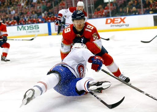 (AP Photo/Wilfredo Lee). Montreal Canadiens left wing Daniel Carr (43) and Florida Panthers defenseman Mike Matheson (19) collide during the first period of an NHL hockey game Thursday, March 8, 2018, in Sunrise, Fla.