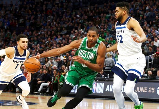 (AP Photo/Jim Mone). Boston Celtics's Al Horford, left, of Dominican Republic, tries to control the ball as he drives into Minnesota Timberwolves' Karl-Anthony Towns, right, in the first half of an NBA basketball game Thursday, March 8, 2018, in St. Pa...