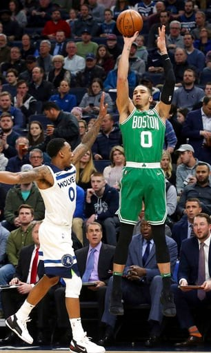 (AP Photo/Jim Mone). Boston Celtics's Jayson Tatum, right, shoots as Minnesota Timberwolves' Jeff Teague defends in the first half of an NBA basketball game Thursday, March 8, 2018, in St. Paul, Minn.