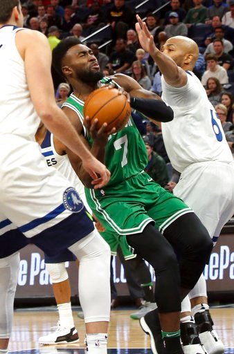 (AP Photo/Jim Mone). Boston Celtics's Jaylen Brown, center, drives between Minnesota Timberwolves' Nemanja Bjelica, left, of Serbia, and Taj Gibson, right, in the first half of an NBA basketball game Thursday, March 8, 2018, in St. Paul, Minn.