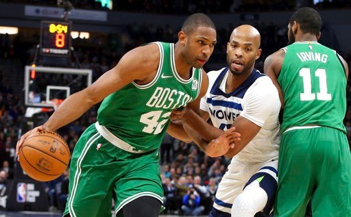 (AP Photo/Jim Mone). Boston Celtics's Al Horford, left, of Dominican Republic , drives around Minnesota Timberwolves' Taj Gibson as Kyrie Irving, right, sets a pick in the first half of an NBA basketball game Thursday, March 8, 2018, in St. Paul, Minn.