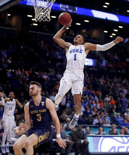 (AP Photo/Julie Jacobson). Duke guard Trevon Duval (1) goes up to dunk against Notre Dame guard Matt Farrell (5) during the second half during the first half of an NCAA college basketball game in the Atlantic Coast Conference men's tournament Thursday,...