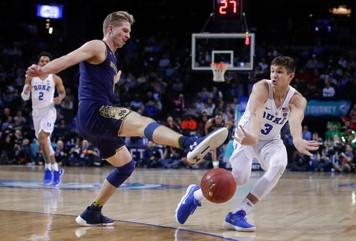 (AP Photo/Julie Jacobson). Duke guard Grayson Allen (3) passes the ball around Notre Dame guard Rex Pflueger (0) during the second half of an NCAA college basketball game in the Atlantic Coast Conference men's tournament Thursday, March 8, 2018, in New...