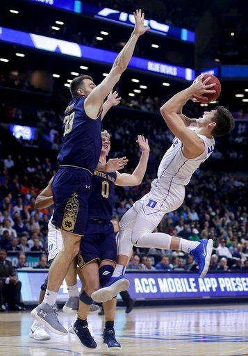 (AP Photo/Julie Jacobson). Duke guard Grayson Allen (3) shoots against Notre Dame forward John Mooney (33) and guard Rex Pflueger (0) during the second half of an NCAA college basketball game in the Atlantic Coast Conference men's tournament Thursday, ...