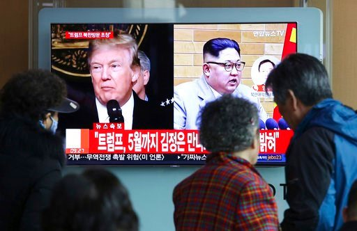(AP Photo/Ahn Young-joon). People watch a TV screen showing North Korean leader Kim Jong Un and U.S. President Donald Trump, left, at the Seoul Railway Station in Seoul, South Korea, Friday, March 9, 2018. Trump has accepted an offer of a summit from t...