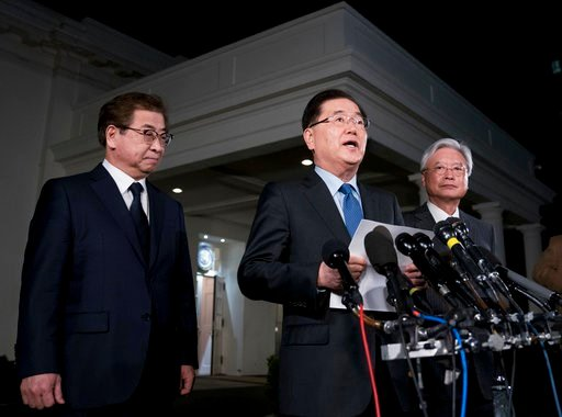 (AP Photo/Andrew Harnik). South Korean national security director Chung Eui-yong, center, speaks to reporters at the White House in Washington, Thursday, March 8, 2018, as intelligence chief Suh Hoon, left and Cho Yoon-je, the South Korea ambassador to...