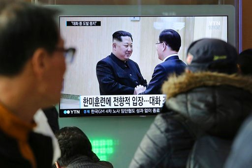 (AP Photo/Ahn Young-joon). People watch a TV screen showing North Korean leader Kim Jong Un, left, meeting with South Korean National Security Director Chung Eui-yong in Pyongyang, North Korea, at the Seoul Railway Station in Seoul, South Korea, Wednes...