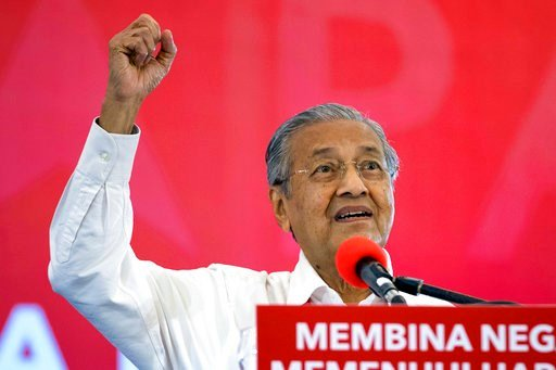 """(AP Photo/Vincent Thian). Malaysia's former Prime Minister Mahathir Mohamad speaks during a political opposition alliance event in Shah Alam, Malaysia on Thursday, March 8, 2018. Opposition coalition """"Pakatan Harapan"""" unveiled its manifesto ahead of th..."""