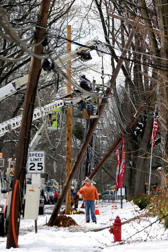 (Tim Tai/The Philadelphia Inquirer via AP). Crews work to replace utility poles in Fairless Hills, Pa. on Thursday, March 8, 2018. Pennsylvania utility companies say more than 110,000 customers were  without power Thursday morning following the state's...